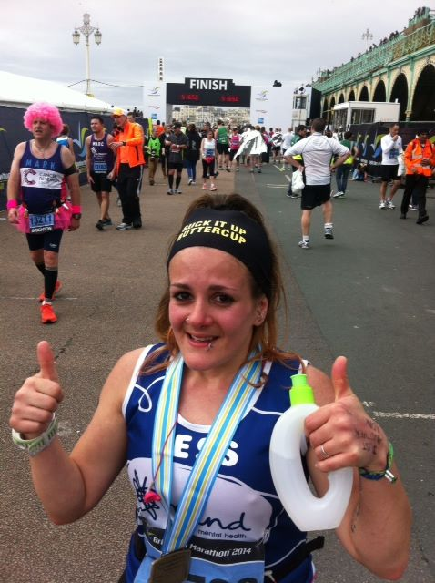 Fitness blogger Tess Agnew at the 2014 Brighton Marathon finish line