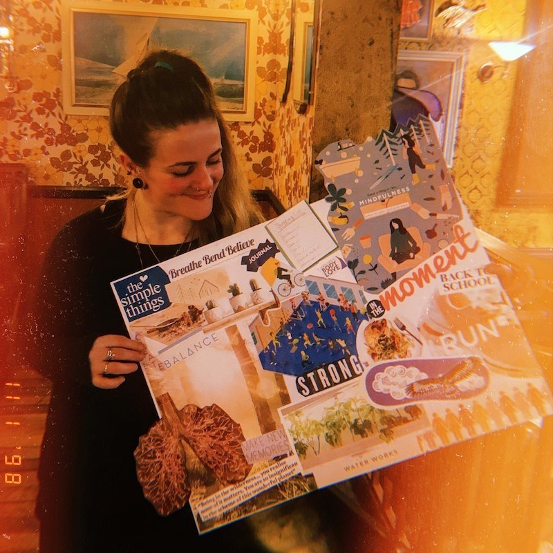 Freelance copywriter Tess Agnew holding a vision board that she made