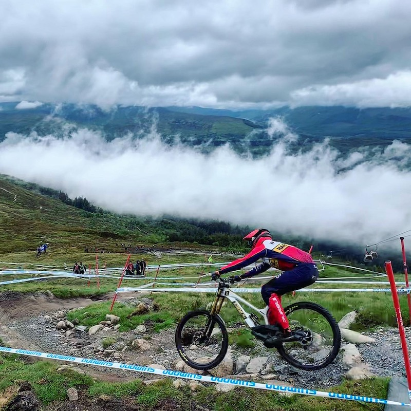 Mountain biker riding the Fort William Downhill World Cup course